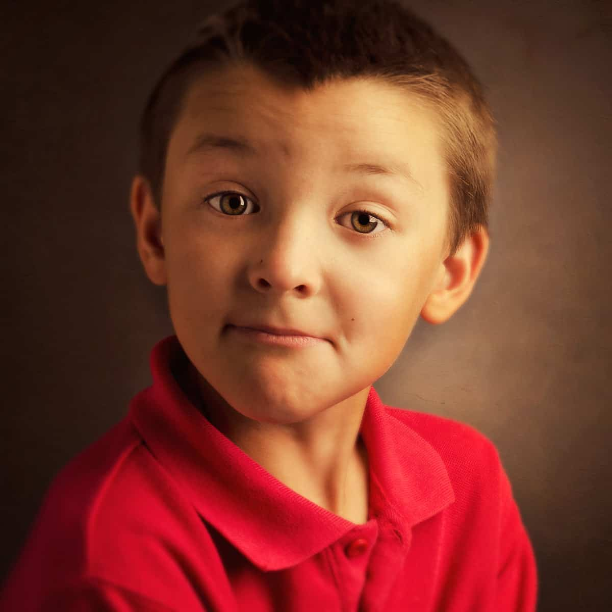 Puzzled Young Boy in Red Shirt