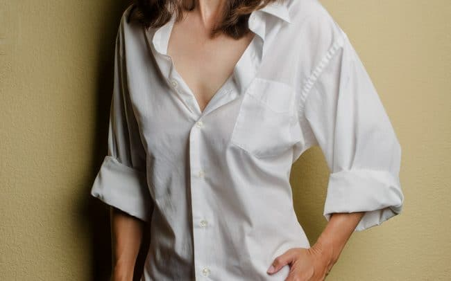 Portrait of Woman in White Button Down Shirt